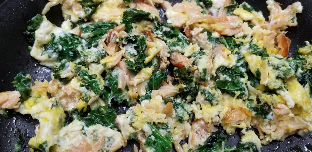 Scrambled eggs with smoked salmon and kale